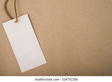 White tag brown background. label kraft paper texture