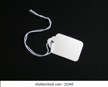 White tag for a tag sale, or office on a black background.