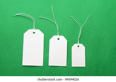 White tags on green