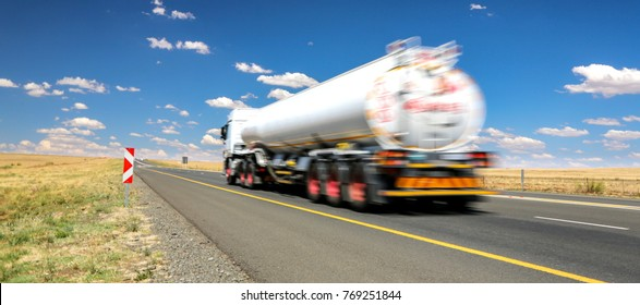 White tanker truck transporting fuel along the tar highway