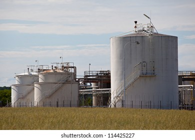White tanks in oil refinery factory