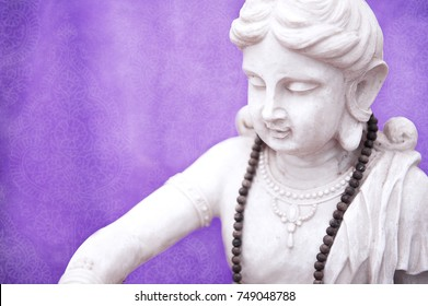White Tara Buddhist Statue with purple backdrop