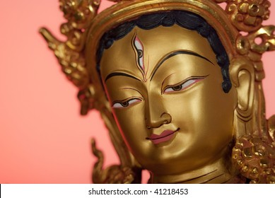 White Tara - one of the main bodhisattva of the Buddhism, a symbol of exclusive purity and transcendental wisdom. The face of gold color with the third eye, close up.