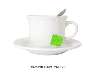 white tea cup with green leaf label. isolated on white
