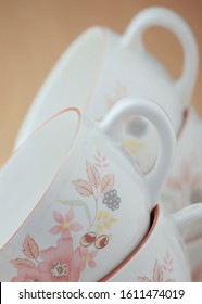 White tea cups are stacked