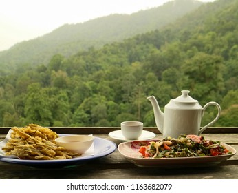White tea with glass and tea backdrop is mountain view.