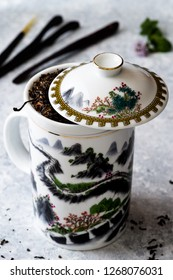White teapot with 'great wall' design, on delicate background
