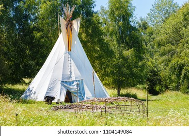 white teepee indian tent and wooden skeleton made for indian saunain.