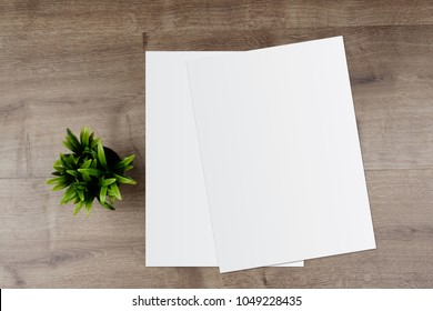 White template paper and space for text on wooden desk