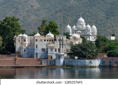 White temple at  a lake in Pushkar, Rajasthan, India