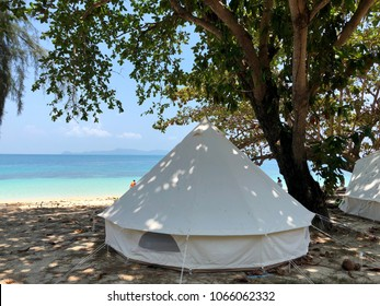 White tent located on the coast.