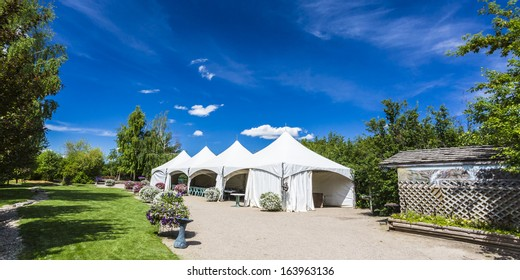 White tents set up for a large party or gathering