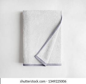 White terry towel top view, bath towel isolated, folded white towel on a white background