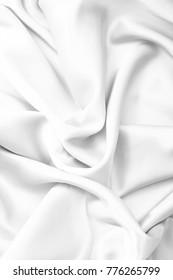 White textile elegant satin crushed material background.