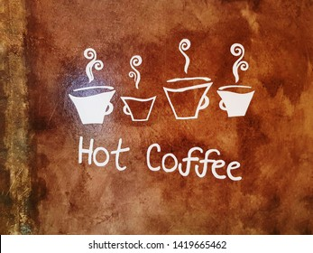 White Texts and Symbols of Hot Coffee on Grungy Brown Wall