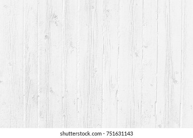 White texture background of old weathered wood. Grayscale wooden wallpaper. Table top view. White washed wood background.