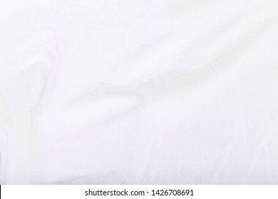 The white texture of the clothes.