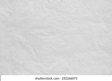 the white textured background from a thin tissue paper or a tracing-paper
