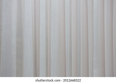 White textured fabric pattern background. White tulle background draped wave organza texture for background copy space