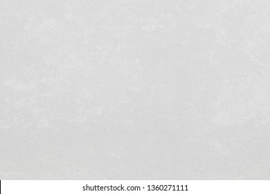 White textured paper background for your art project with space for text or image.