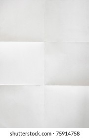 white textured sheet of paper folded in six