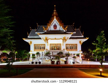 White Thai temple at night. Phuket island.