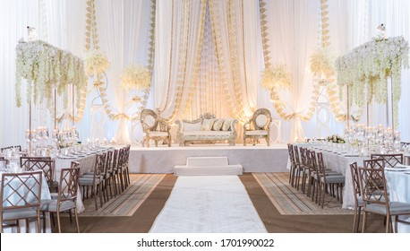 White Themed Wedding Decor with Large floral centerpieces