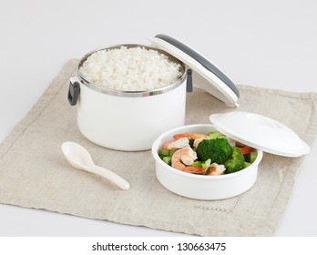 white tiffin carrier with rice and fried shrimps and broccoli