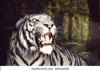 White Tiger yawns on the green foliage background. Close up