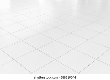White tile floor background in perspective view. Clean, shiny, symmetry with grid line texture. For decoration in bathroom, kitchen and laundry room. And empty or copy space for product display also. - Shutterstock ID 588819344
