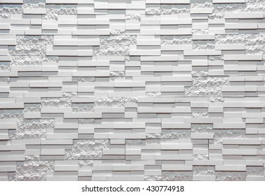 White tiled wall for background.