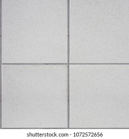 White tiles floor. Closed up of white glossy ceramic brick tiles floor texture, seamless tile pattern in a bathroom.