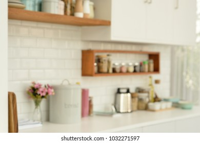 white tiles wall modern kitchen with ingredients on white table