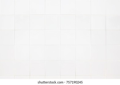 White tiles wall texture  for the decoration of the bedroom.
