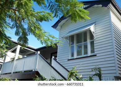 White timber frame house, Queenslander style, traditional house, high set for subtropical climate
