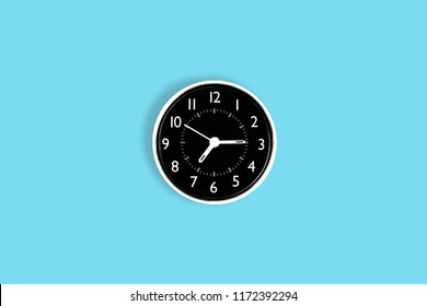 white time clock on blue pastel desk or wall