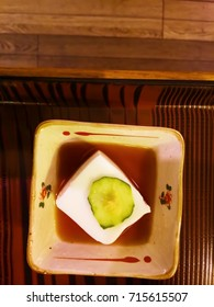 White tofu with pickled cucumber garnish on top. Traditional Japanese food.