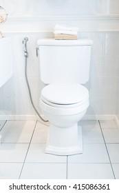 White toilet bowl in a bathroom