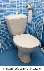 White toilet bowl in blue interior