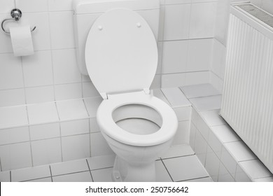 White Toilet Bowl In A Clean Hygienic Bathroom