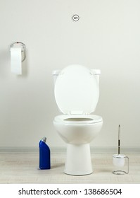 White toilet bowl and  cleaner bottle in a bathroom