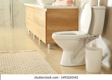 White toilet bowl in modern bathroom interior