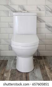 White toilet bowl in modern bathroom, selective focus