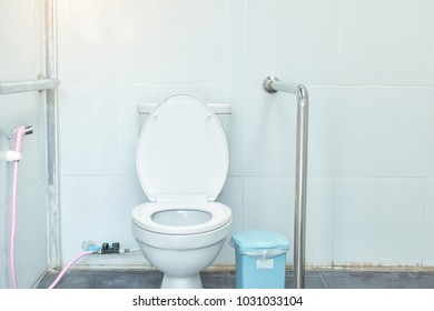White toilet bowl in the public bath. Toilet for the disabled.The bathroom is elegant and modern.Toilet seat decoration in bathroom interior,For home and office.