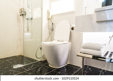 White toilet bowl seat decoration in bathroom interior