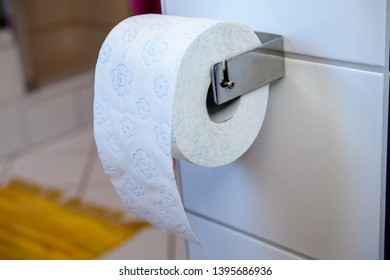 white toilet paper on wall with white tiles
