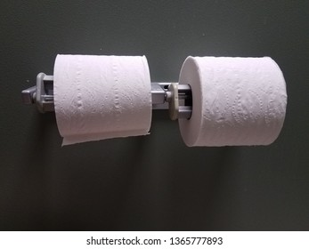 white toilet paper rolls in bathroom or restroom stall