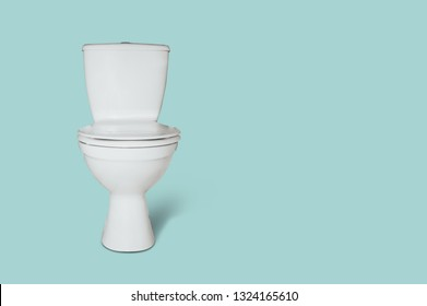 White toilet seat isolated on a pastel background. The concept of selling armature to the toilet, bathroom.