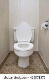 White toilet seat with tissue rolls