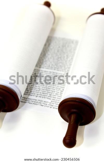 white Torah scroll on a light background